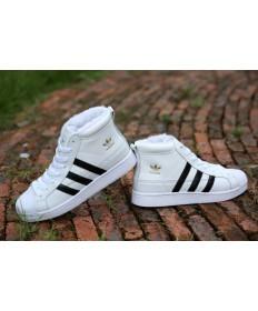 las zapatillas de deporte Adidas Superstar hi-top de piel blanco/negro