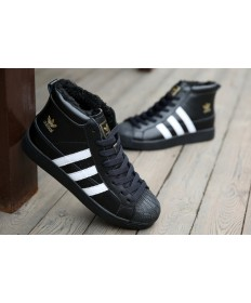 Adidas Superstar high top zapatillas de deporte de piel negro/blanco