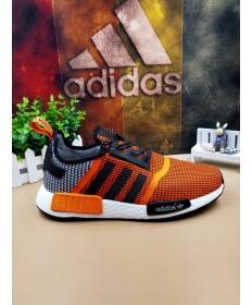 en blanco y negro de Adidas NMD Los Ángeles las zapatillas de deporte de color naranja
